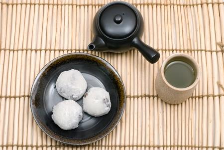 Japanese rice cake stuffed with sweetened bean jam named Daifuku-mochi photo