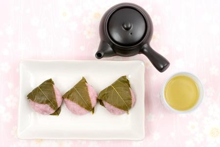 Japanese rice cake(doumyouji rice flour) covered with sweetened bean jam wrapped in a preserved cherry leaf named Doumyouji-sakuramochi(West style sakuramochi) photo
