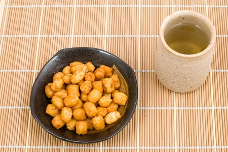 Japanese baked small pieces cuts rice cake snack named Arare photo