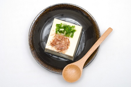 Japanese sprinkle spice and put soy sauce on the cold Tofu(bean curds) named Hiyayakko