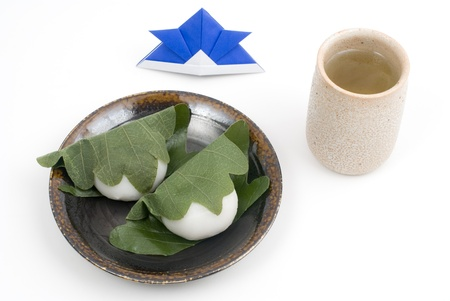 Japanese rice cake stuffed with sweetened bean jam, wrapped in oak leaf, for Children's Day(May 5th). named Kashiwamochi Stock Photo - 9973404