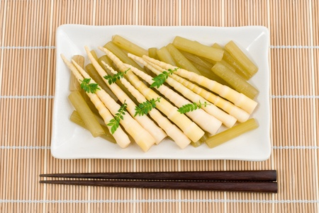 Bamboo shoots and giant butterbur boiled in stock photo