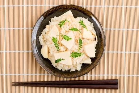 Japanese steamed rice(gohan) with bamboo shoots(Takenoko) mixed in advance named Takenoko-gohan photo