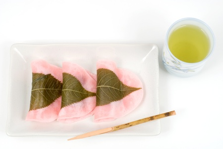sweetened: Japanese rice cake covered with sweetened bean jam wrapped in a preserved cherry leaf named Choumeiji-sakuramochi(East style sakuramochi) Stock Photo
