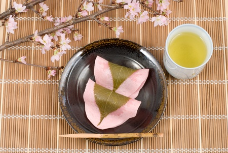 Japanese rice cake covered with sweetened bean jam wrapped in a preserved cherry leaf named Choumeiji-sakuramochi(East style sakuramochi) Stock Photo