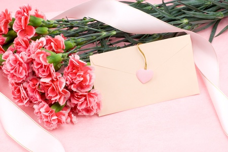 Pink carnation bouquet and letter 스톡 콘텐츠