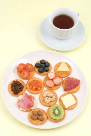 Various food topped cookies and tea photo