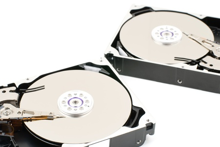 Opened hard disk drive on a white background 스톡 콘텐츠