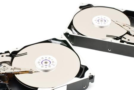 disco duro: Unidad de disco duro abierto sobre un fondo blanco Foto de archivo