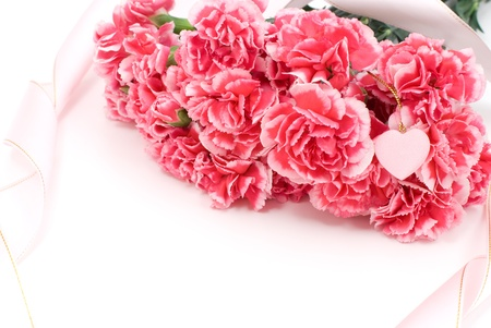 Pink carnation bouquet and ribbon with heart mark