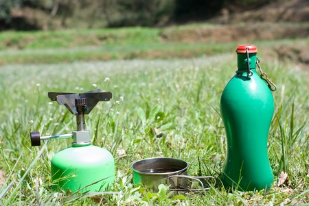 Green outdoor cookware in grassy place photo