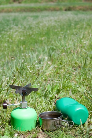 cookware: Green outdoor cookware in grassy place