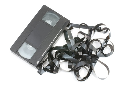 Tangled video tape isolated on white background photo