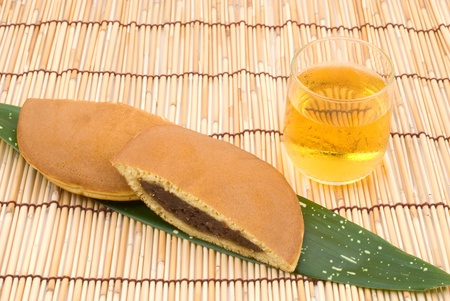 Japanese bean-jam pancake (Dorayaki) and green tea photo
