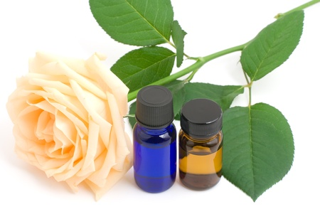 Essential oil and rose on white background Stock Photo - 12329246