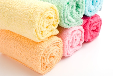 laden: Multi color of laden rolled towels on a white background