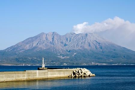 Active volcano and volcanic plume facing the sea called Sakurajima in Kagoshima, Japan