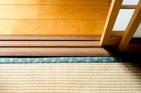Wood floor and straw mat divided with paper sliding door Stock Photo - 13046912