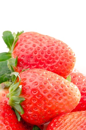 laden: Close up of laden strawberry on a white background Stock Photo