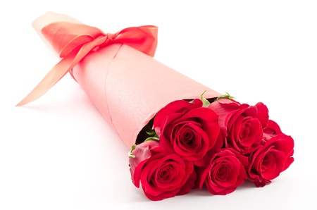 Paper wrapped red rose bouquet on white background