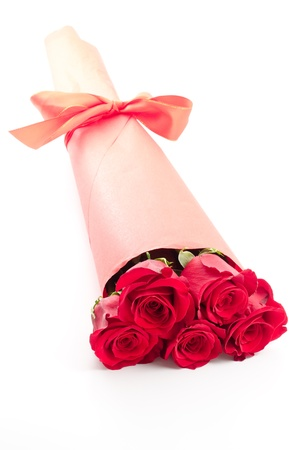 Paper wrapped red rose bouquet on white background in vertical position photo