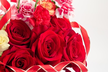 Bouquet of red rose and carnation with ribbon photo