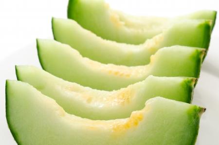 neatly: Neatly arranged cut melon on the plate