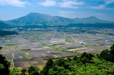 Cultivation area in front of mountains from Aso Kumamoto, Japan Stock Photo - 14510249