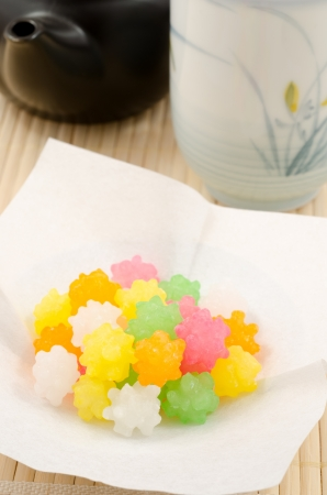 Colorful japanese sweet sugar candy on white paper in vertical position Stock Photo - 15640276