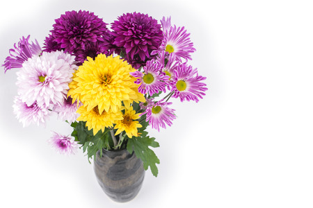 Colorful chrysanthemum flowers were placed in a vase from overhead photo