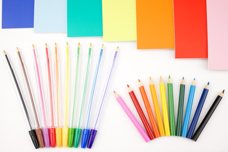 portrait orientation: Colorful pens placed in a portrait orientation and notes on a white background