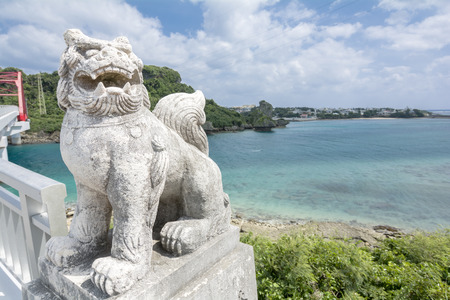 subtropics: Japanese traditionally guardian lion sculpture near the sea Stock Photo