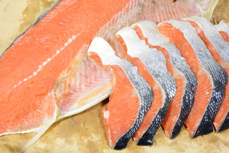 salmon falls: Large fillet and small fillets of cut salted salmon