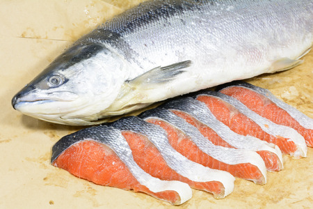 Whole and six fillets of salted salmon