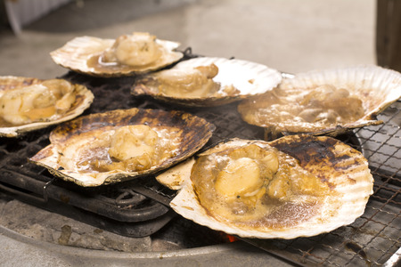 soy sauce: Soy sauce poured on scallops which baked in charcoal fire