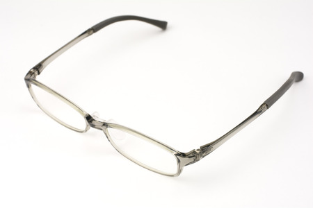 front facing: From an oblique angle of plastic frame glasses facing front on a light gray background