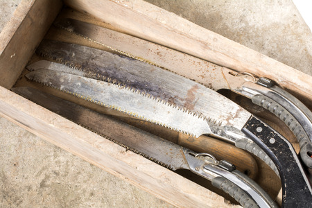 worn out: Worn out saws in the wooden box