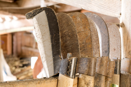 worn out: Line of worn out billhook and beginning used billhook Stock Photo