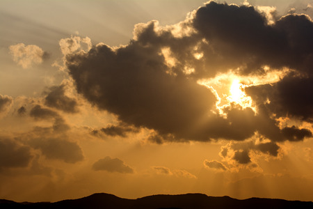 crepuscular: Crepuscular rays from floating cloud covering the sun at sunset