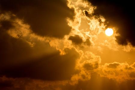orange sunset: Floating clouds and sun at orange sunset Stock Photo