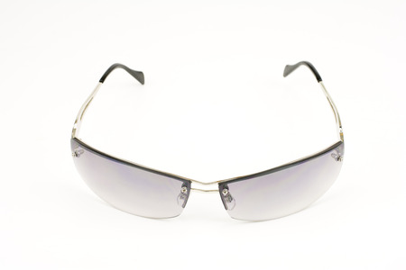 front facing: Gray sunglasses facing front on a light gray background