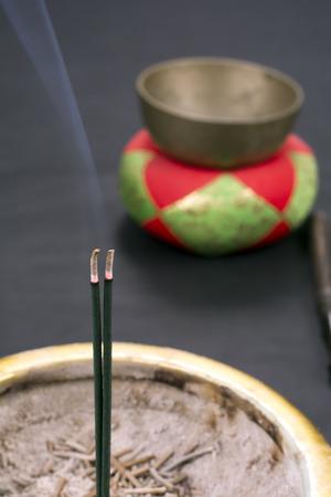 singing bowl: Smoke of burning incense sticks in front of singing bowl for buddhism