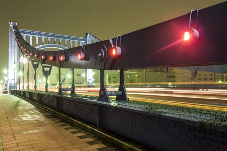 light up: Close up of light up Kiyosu bridge and car light trails in Tokyo at night