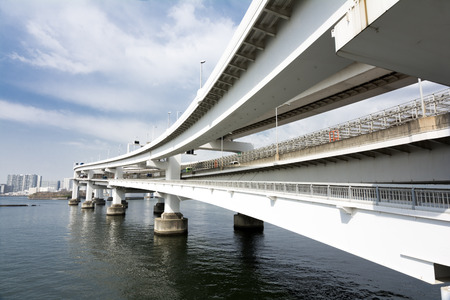 overlapped: Overlapped highway over the sea and in front of buildings in Tokyo bay area