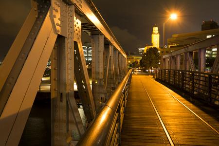 irradiate: Walkway of wood floor bridge in front of historical building in Yokohama at night Stock Photo