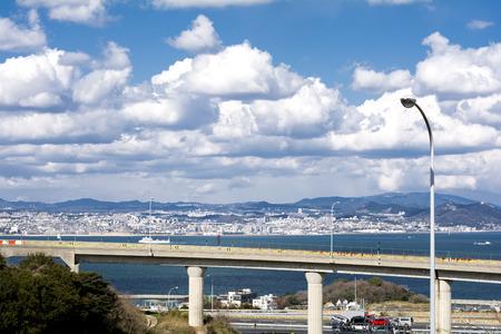 schlagbaum: Seashore highway viaduct under sky in Awaji city in front of Kobe city