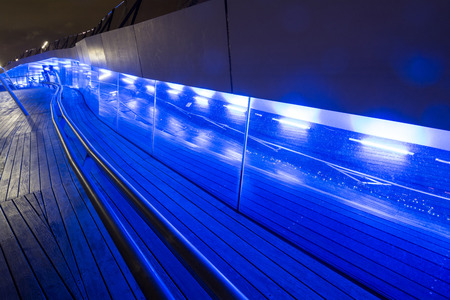 hand rails: Blue lighting along the wood floors in Yokohama at night