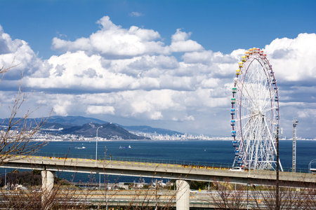 speedway park: Ferris wheel and highway viaduct under sky in Awaji city