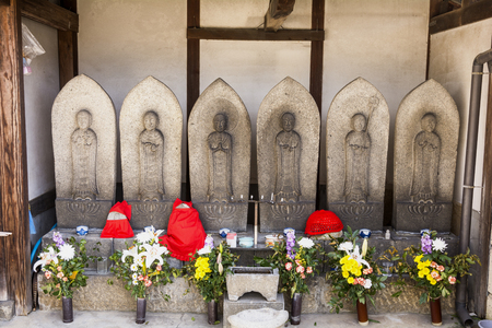 deity: Lined six Guardian deity of children with flowers in Onomichi, Hiroshima