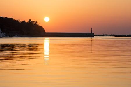 lull: Orange view of sunset sea with embankment in Shimonoseki, Yamaguchi Stock Photo